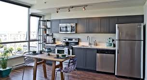 gray kitchen cabinets black countertop gray kitchen cabinets brass