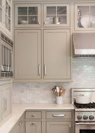 white kitchen cabinets with taupe backsplash neutral painted cabinets gray greige taupe and gray