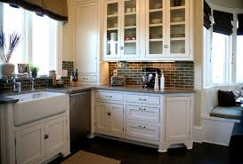 Apron Sink With Backsplash by Brown Tile Backsplash Kitchen Traditional With Beige Cabinet Beige