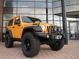 orange jeep wrangler jeep wrangler and cherokee set sales records morris 4x4 center blog