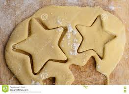rolled biscuit dough with star shapes cut out stock photo image