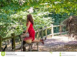 woman kneeling on park bench stock photo image 74892750