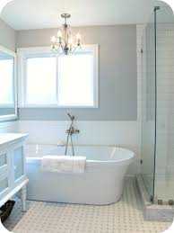 small bathroom with freestanding tub as well as featuring