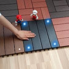 Wood Patio Flooring by Wood Plastic Composite Flooring With Solar Light Outdoor Garden