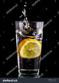 drink splash splash water lemon over black background stock photo 119700742
