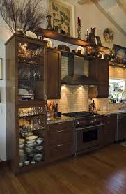 space above kitchen cabinets ideas 63 best above cabinets staging images on decorating