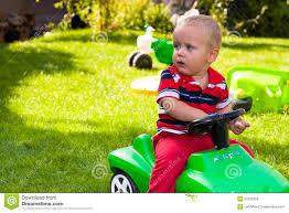 toddler car toddler driving toy car outdoors stock image image 22229389