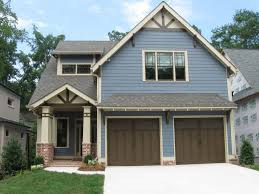 amusing house color schemes exterior brown roof wooden garage door