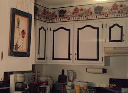 white kitchen cabinets with cathedral doors they tried painting the cabinets countertops see the results