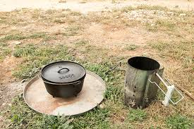 dutch oven cooking table cast iron dutch oven accessories what you need and don t need