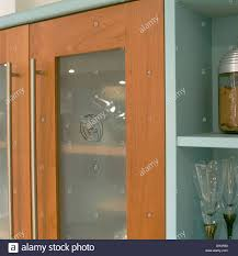 up modern kitchen close up of modern kitchen cupboard doors with engraved opaque
