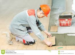 Renivation by Two Tilers At Industrial Floor Tiling Renovation Stock Photos