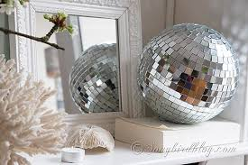 mantel decoration with cherry blossoms and a disco