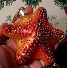 merck family world orange front starfish
