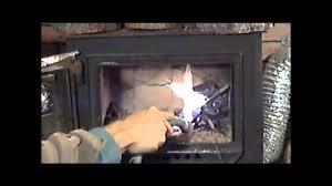 how i burn wet frozen green unseasoned fire wood in my stove youtube