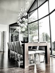 contemporary dining room with windows u0026 glass bubble chandelier