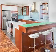 modern stylish kitchen designed with raised breakfast bar team up
