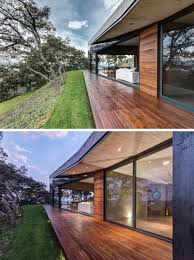 a butterfly roof contains this house on a hillside in mexico