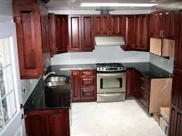 granite countertop kitchen design with dark cabinets tile