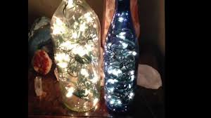 diy wine bottle filled with lights aka bottles