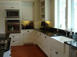 farmhouse kitchen design built in stoves oven brown varnished wood