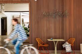 say aloha to waikiki u0027s newest 1960s style beach bungalow motel
