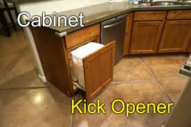 cabinet door opener kick to open youtube