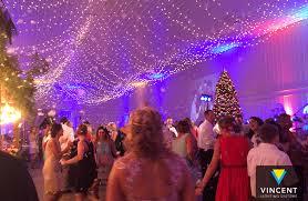falling snowflake christmas lights christmas in july wedding reception