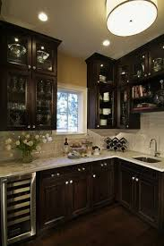 dark wood cabinets in kitchen traditional dark wood kitchen design with glass cabinetry