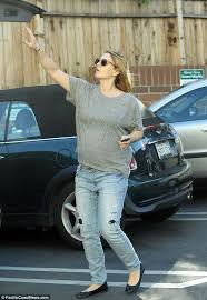 drew barrymore shows blossoming baby belly as she goes
