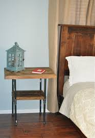 butcher block and iron pipe bedside table naptimediyer it turned out so well that i already bought the supplies to make side tables for our sunroom