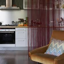 open plan room living room area kitchen fringed curtain room
