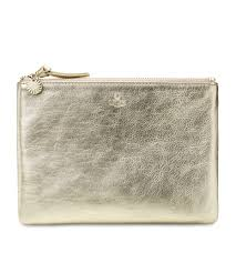 ugg boots bags accessories on sale up to 70 at tradesy discounted ugg medium zip pouch metallic ugg clutch bags in
