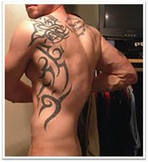 tribal libra tattoo on upper back