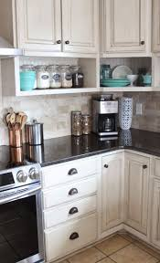 kitchen raised wall cabinets with shelves built underneath namely