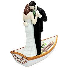 wedding toppers and groom row away wedding in rowboat wedding cake topper