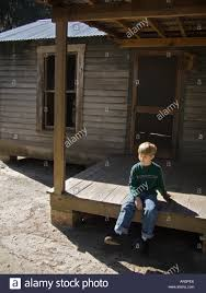 boy sitting on front porch fl cracker house waiting marjorie