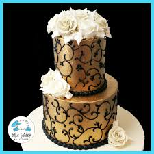three tier black u0026 gold cake with sugar flowers for 60th birthday