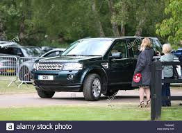 land rover queens prince philip drives the queen to the cartier queens cup polo