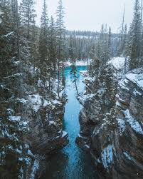 the beginning of winter at athabasca falls in jasper national park
