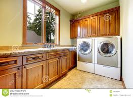 Laundry Room Cabinets by Luxury Laundry Room With Wood Cabinets Stock Images Image 28020644
