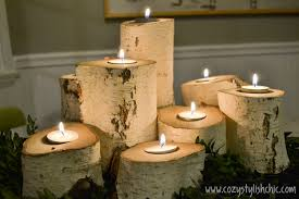 diy how to make a set of tree stump candle holders for the holidays