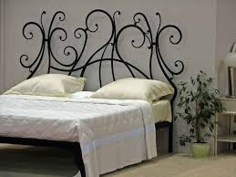 art deco black metal modern headboard in a bedroom with grey art deco black metal modern headboard in a bedroom with grey painted walls
