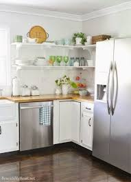 open shelving kitchen white brackets and subway tile backsplash