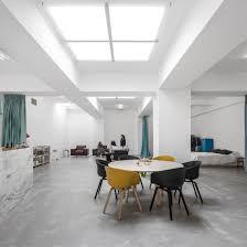 atelier arranges a garage into a home for a young couple fala atelier arranges a garage into a home for a young couple