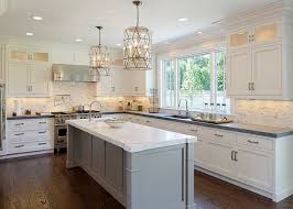 beautiful kitchen features a white kitchen island topped with gray