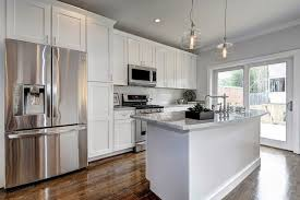 white kitchen cupboards and grey walls shaker cabinets transitional kitchen haute indoor couture