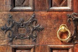 fragment of vintage wooden door with ornament and golden