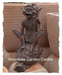 resin large pixie on a snail garden ornament woodside garden