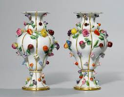 a pair of ornamental vases with applied fruit and flowers meissen
